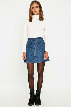 pair skirt with white top and ankle boots