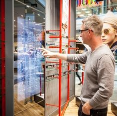 Opticians store wows customers with mirrored point of sale system that encourages online social interaction.