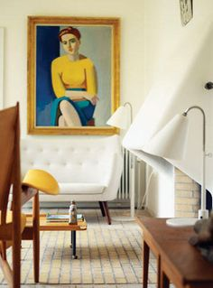 Finn Juhl sofa. Gorgeous portrait. yellow, wood and white.  everything basically.