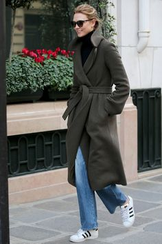 5 March Karlie Kloss paired her green coat with blue jeans and Adidas trainers while out and about in Paris. - HarpersBAZAAR.co.uk