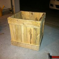 Built planter box out of an old pallet Made these from a few pallets. The final product has a muscadine vine flanked by raspberries.
