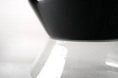 KORO End Table - Close Up. Similar to the Table Lamp, Sconces, and Lampposts, the End Table also was designed in diverse Murano textures.  Here we emphasize the classic Murano glass in crystal and black.