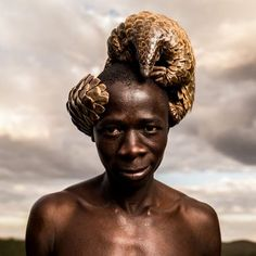 Pangolin on head photograph by Adrian Steirn