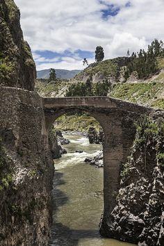 Bridge extends over a river in the Colca Canyon