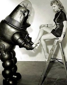 robot putting shoes on a 50s woman.jpg (442×557)