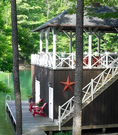Rooftop Deck - stairs and a rooftop deck added to an existing boathouse, creating more outdoor entertaining space. Tin star from a flea market. Read more: Home Decorating Ideas - Rustic Decor - Country Living Lake Cabins, Cabins And Cottages, Lakeside Living, Outdoor Living, Cabana, Porches, Cabin Decks, Georgia, Summer Cabins