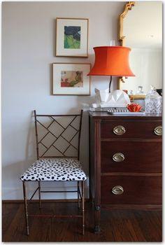 LOVE the orange lamp shade,    metal chair, lamp with orange shade,  wall art