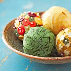 Decorative Orbs - Turn ordinary items into coffee-table decor. Easy to switch when your room changes, these foam or wooden balls are wrapped with ribbon scraps, old tape measures, and leftover scrapbooking supplies. Place them in a pretty bowl for display.