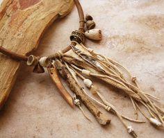 Desert Primitive Amulet Pouch and Artifact Necklace. $365.00, via Etsy.
