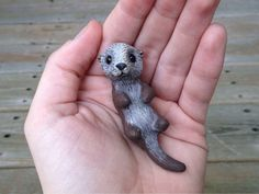 Sea Otter: Handmade miniature polymer clay animal by AnimalitoClay