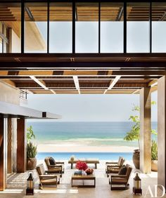 Hunziker outfitted the main terrace with Sutherland furniture of his own design and pillows in a Ralph Lauren Home fabric | archdigest.com