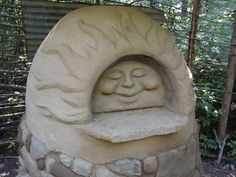 This happy cob oven was built at Deanne Bednar's Straw Bale Studio (strawbalestudio.org) in Oxford, MI