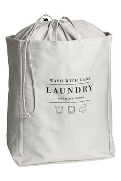 Small laundry bag in cotton twill with printed text, two handles, and plastic coating inside. Top section in lighter-weight fabric with a Laundry Shop, Small Laundry, Laundry Rooms, Laundry Business, Laundry Design, Plastic Coating, H&m Home, Laundry Service, Fabric Bags