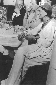 Coco Chanel - a rare moment...relaxing with friends....i'm sure she no doubt had her presnt collection on the back of her mind...