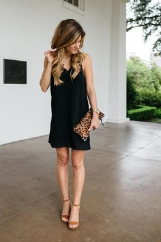 All about my hair extensions // wearing a little black slip dress with a leopard print clutch // summer going out outfit // wearing black and brown together for summer