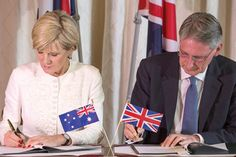 Minister for Foreign Affairs, Julie Bishop, and UK Foreign Secretary, Philip Hammond, sign the MOU on crisis cooperation