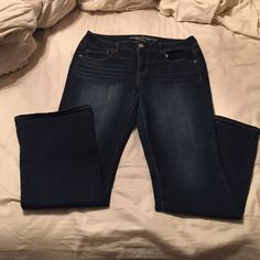 Like new American eagle kick boot jeans Like new American eagle kick boot dark wash jeans. Only worn twice. American Eagle Outfitters Jeans Boot Cut