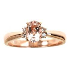 <li>Oval-cut morganite and diamond ring</li><li><a href='http://www.overstock.com/downloads/pdf/2010_RingSizing.pdf'><span class='links'>Click here for ring sizing guide</span></a></li>