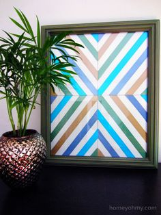 Homey Oh My!   Create this easy wall art with just some poster board and ribbon.
