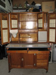 """Competed Restoration 48"""" SELLERS Brand, Hoosier Style cabinet. Restored as a Christmas present from My wonderful Husband of 53 years Dale Deckard.  Perfect in my Laundry room."""