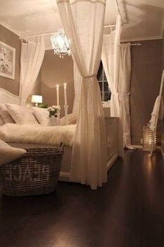Easy and inexpensive ways to put a little romance in your room. White Christmas lights, drapes for drama on four corners of the bed. Again muted tones create a peaceful environment. #bedroom #inspiration #vlgcommunities | best stuff