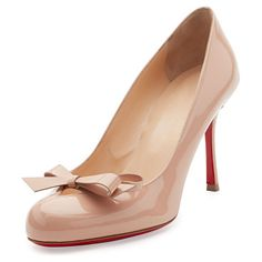 """Vinodo Patent Bow 85mm Red Sole Pump by Christian Louboutin. Christian Louboutin patent leather pump. Available in multiple colors. 3.3"""" covered heel. Round toe. Keyhole vamp wit..."""