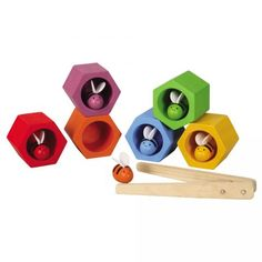 Beehives - Teach your child about color matching and dexterity with this simple bumblebee puzzle from Plan Toys, the green toy company. Made of natural, sustainable materials and non-toxic paints, this colorful game is designed to help young children learn about colors and practice their manual dexterity. Each player takes turn matching a bee to its beehive, and flying it home with the pincers. Bonus points to the player who never drops a bee or disturbs the hive!