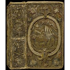 Embroidered Book Cover ~ England, Great Britain ~ 1631 ~ Canvas covered with satin, embroidered with silver and silver-gilt threads, spangles and colored silk ~ The design on the back and front consist of an oval cartouche with a soldier in armor and helmet with raised visor pointing to the sun emerging from clouds above.  The binding contains a copy of the Bible printed in London in 1631 ~ V & A Museum