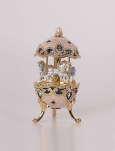 White Faberge Egg with Horse Carousel by Keren Kopal Handmade Decorated with Swarovski Crystals Gold Plated