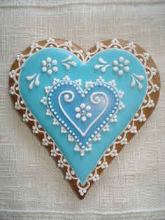 A positively gorgeous blue and white lace decorated heart shaped cookie. #heart #cookie (I liked Wink's description so much, I kept it. I mean, it IS positively gorgeous!)