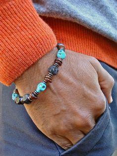 Men's Rocker Bracelet with Carved Turquoise Skulls von tocijewelry