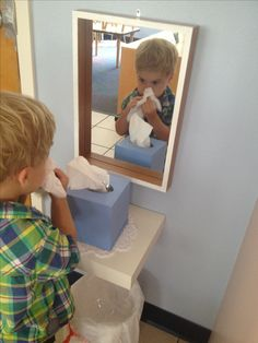 My co teacher had the best idea! We made a nose wiping station. We set up a mirror, shelf, tissues and a trash can. The kids can look I the mirror and see how to wipe their noses. We will use it later for emotion cards and other exercises!