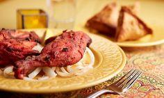 The menu includes palak aloo, naan, karahi shrimp, lamb vindaloo, vegetable curry, chicken biryani, samosas, and gulab jamun