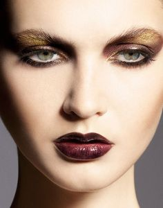 Dark lips and eyes with a touch of yellow.