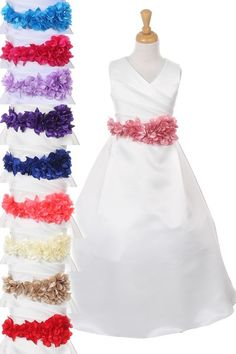 http://childrensdressshop.com/home/131-satin-flower-girl-dress-with-ruffled-silke-flower-sash.html  this long forma satin ivory dress can come with a brown, gold, or champagne flower sash