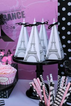 Paris themed parties are always so sweetly decorated with pretty shades of pink, Eiffel towers, and even pink poodles!