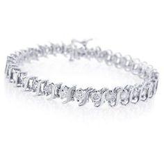 http://103rdavenue.com/paris-jewelry-10k-white-gold-2-carat-diamond-s-link-tennis-bracelet/ 10K White Gold 2 Carat Diamond S-Link Tennis Bracelet (I-J, I2-I3). High End Designer fashion Exquisite sophistication around your wrist. This stunning tennis bracelet showcases gorgeous Genuine diamonds set into a feminine creation of d...
