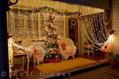 This brilliant display of Christmas lights turns a front porch into a magical cozy Christmas setting at a resident's house in Pukeuri on the South Island of New Zealand. The hanging white lights creates the impression of curtains as two comfy chairs sit between a nicely decorated tree.  This porch is just the beginning of the display as the walkways, gardens, tables and sheds are all covered in Christmas lights. As you wander through the gardens, pay close attention to the small children as ...