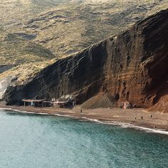 Red Beach, Akrotiri, Santorini. I'm thinking that must be lava cliffs, since Akrotiri was destroyed during an eruption of Thera.