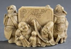 """A Japanese ivory netsuke of immortals. Late 19th century. Seven immortals gathering around a screen. Himotoshi using natural pennings. Signed on the bottom: """"Ichigyoku"""". 1 1/2""""h x 2 1/2""""w."""