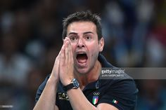 Italy's coach Gianlorenzo Blengini reacts during the men's Gold Medal volleyball match between Italy and Brazil at the Maracanazinho stadium in Rio de Janeiro on August 21, 2016, at the Rio 2016 Olympic Games. / AFP / Juan Mabromata