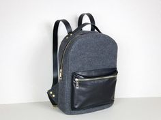Backpack made of vegetable tanned leather, full grain leather and felt.  Closes on the zip.  It has got regulated straps.  Size: 36cm x 28cm x 18cm    All products are handmade in our manufacture in Poland  Best material and quality.