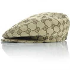 This is an authentic GUCCI Monogram Driver Hat Large NEW.   This stylish driver hat is crafted of Gucci GG brown on beige cotton canvas.