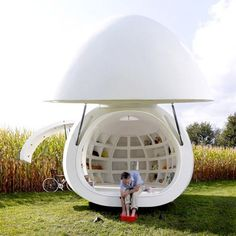 Egg House Pod designed by belgian architectual firm dmvA. The egg house consists of a bathroom, kitchen, lighting, a bed and storage.