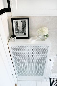This easy DIY tutorial shows you how to make a radiator cover to cover those unsightly or unused radiators you might have in your home. Diy Bathroom, Diy Heater, Wall Heater Cover, Bathroom Themes, Small Bedroom Storage, Bathroom Makeover, Bathroom Decor Themes, Diy Radiator Cover, Bathroom Radiators