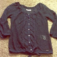 Hollister navy blue top Hollister navy blue all over lace top. Sleeves are about elbow length. All the buttons do come undone. Also a string at the very bottom to tie a bow or you can take the string out. From smoke free home. I ship fast and answer any questions! Hollister Tops Blouses