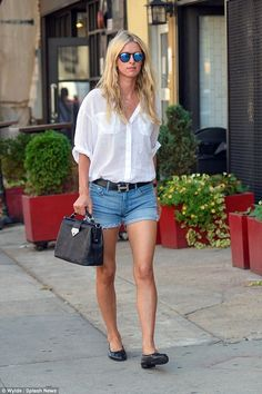 bcddf1fe65 Newly-wed Nicky Hilton displays her long legs in thigh-skimming shorts