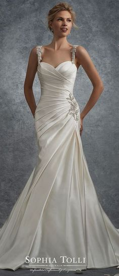 Satin fit and flare wedding dress with beaded straps. Sleeveless soft duchess satin gown with crystal encrusted hand-beaded straps, sweetheart neckline, directionally draped bodice with matching beaded accent at hip, asymmetrically dropped waist, back corset, court length train.