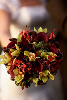 Gorgeous - the deep wine & purple flowers contrasting the pale green orchids gives great texture!