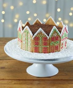 Revamp your traditional Christmas cake with this beautiful gingerbread house design, great for those who are skilled with piping.